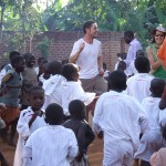 Peak Active Sport's Steve Brackenridge with kids in Uganda